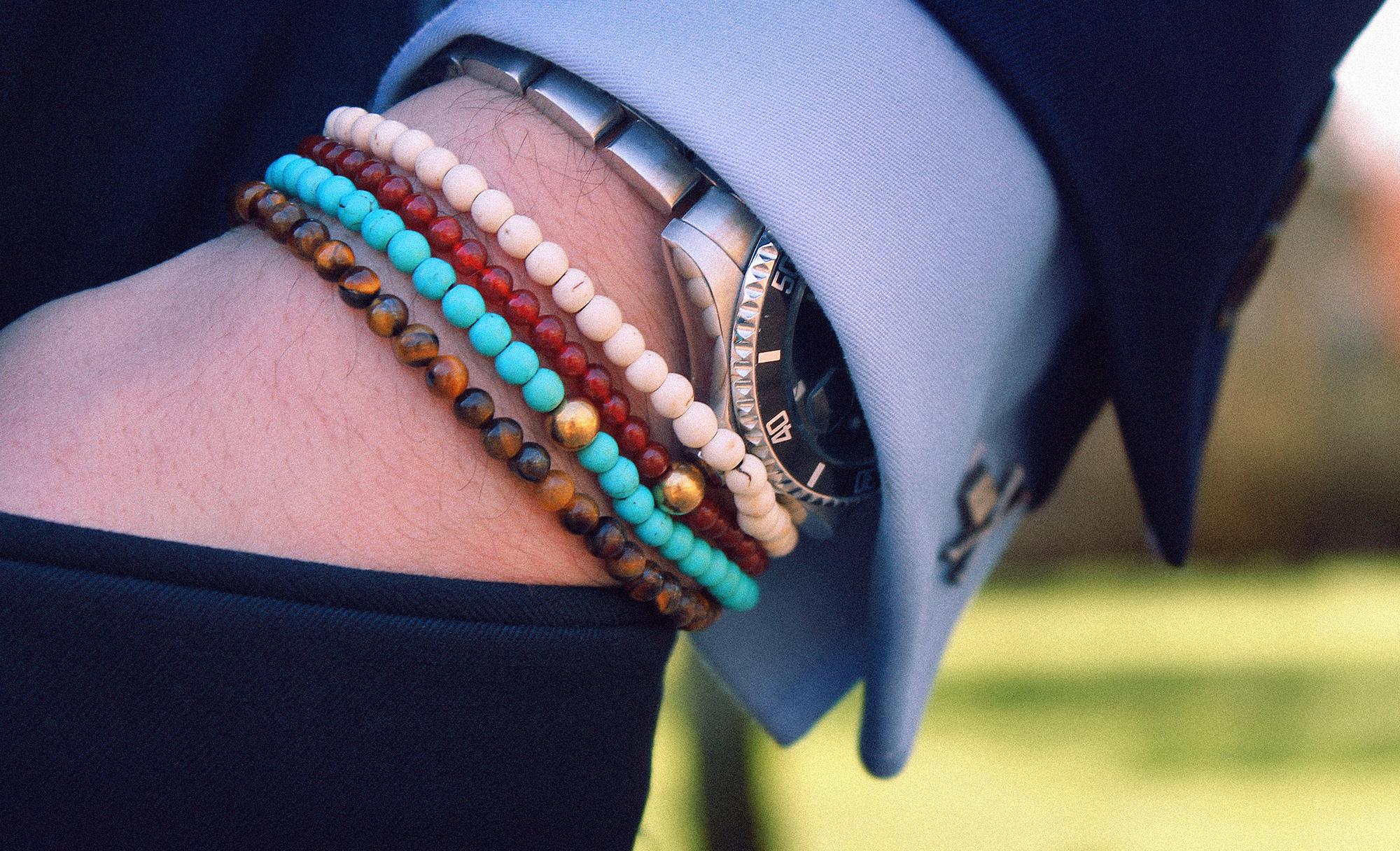 Men beaded bracelets and watch