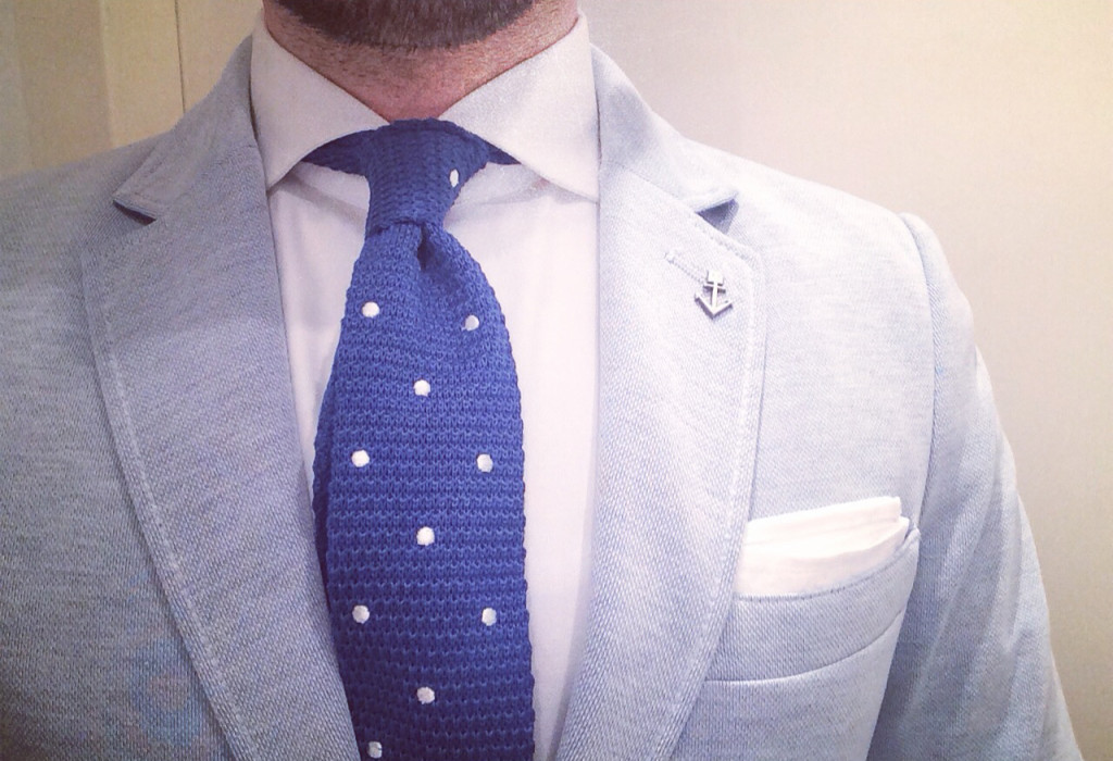 Navy blue polka dot tie